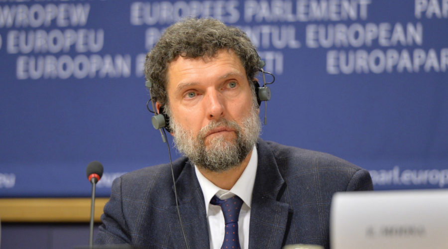 BRUSSELS, BELGIUM - DECEMBER 11:  Member of the International Peace and Reconciliation Initiative (IPRI) delegation to Turkey Osman Kavala is seen during a joint press conference with Chair of the Confederal Group of the European United Left - Nordic Green Left at the European Parliament Gabriele Zimmer, Chair of IPRI Judge Essa Moosa, French politician Francis Wurtz and Chair of the EU Turkey Civic Commission (EUTCC) Kariane Westrheim after 11th International Conference on the European Union, Turkey, the Middle East and the Kurds at European Parliament headquarters in Brussels, Belgium on December 11, 2014. (Photo by Dursun Aydemir/Anadolu Agency/Getty Images)